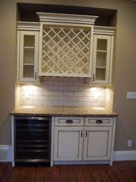 antique white kitchen cabinets with subway tile backsplash antique white cabinets wine cabinet stainless steel wine