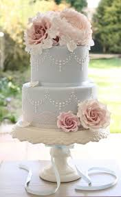 two tier wedding cake with cupcakes wedding cake flavors