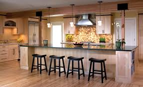 white cabinets and large kitchen island in brown painted with
