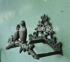 cast iron birds on tree hose pipe reel holder garden hose