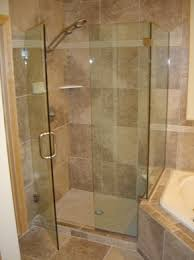 frameless glass shower doors over tub door with inline notched panel and 90 degree return panel over a