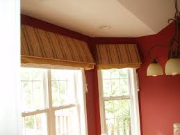 designers touch in canopy shaped cornice board with soft valance