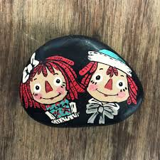 raggedy ann and andy hand painted rock by rocksnest on etsy https