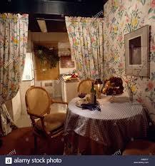 interiors diningroom drapes stock photos floral dining room