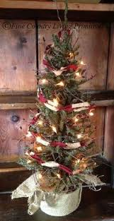 primitive fully decorated table top tree