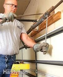 Garage Door Torsion Spring Winding Bars by Advanced Garage Overhead Door Repairs Family Handyman
