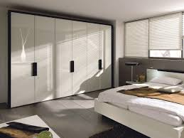 Small Bedroom Built In Closet White Wardrobes With Sliding Door In Colorful Bedroom Design From