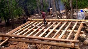 log floor log cabin on a budget ep 9 sill logs floor joists