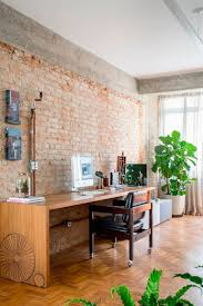 brick wall apartment exposed concrete and brick walls highlighted in apartment renovation