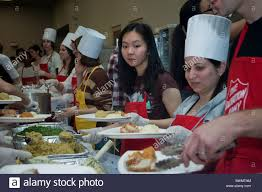 salvation army serves thanksgiving dinner to the neediest at the