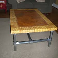 diy table for living room with wooden top and frame from pvc pipe