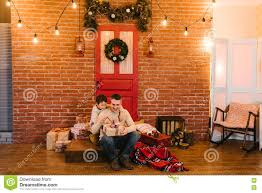 the father gives his son a gift for christmas stock photo image
