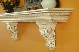 a heavy large mantel shelf with solid wood acanthus leaf corbels