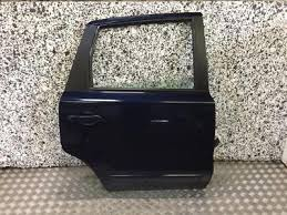06 13 nissan note o s r driver off side rear door red paint code