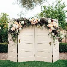 wedding backdrop doors whimsical vintage chic wedding inspiration floral garland