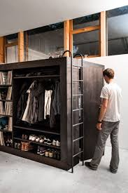 apartement home loft bed among hidden black door near shoes