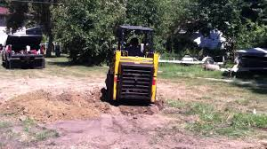 mustang 320 skid steer mustang 320 skid loader moving dirt for a garage floor