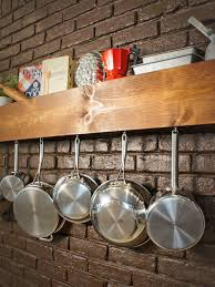 kitchen accessories brown painted brick wall wooden wall mounted