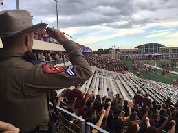 texas state students sit in during national anthem before uh game