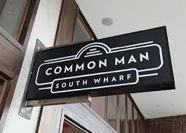 common man south wharf restaurant storefront signage signage