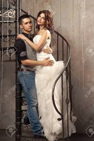wedding dress cast beautiful posing at cast iron stairway in wedding
