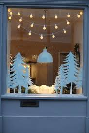 how to hang christmas lights in window these lights are so pretty love the effect of them hanging in the