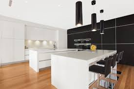 black and white kitchen with black pendant lights position
