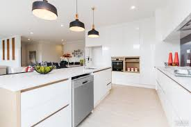 white and wood merge to warm effect in this kitchen design