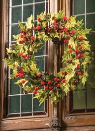 a gorgeous christmas mantelpiece holly ivy wax flower cones