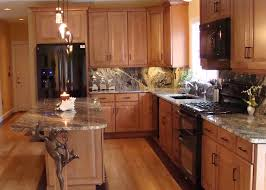 Kitchen With Black Cabinets Kitchen With Black Appliances Glazed Maple Cabinets Gray Marble