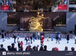 new york city rockefeller center skating rink at christmas tree