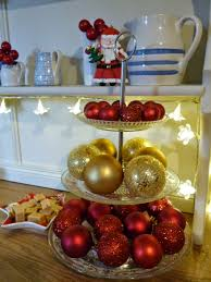 make a christmas table decoration using a cake stand and baubles