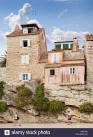 houses and apartments clinging to a natural rock foundation split