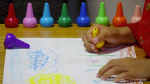 gallereplay child drawing with crayons