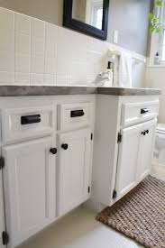this taylored house bathroom vanity makeover so we painted the