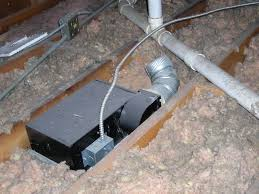 a bathroom fan venting in to the attic area as noted during a