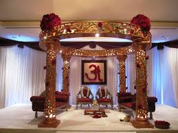 traditional indian wedding mandap with large red rose clusters