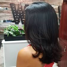 layered cuts for medium lengthed hair for black women in their late forties medium length straight layered black hair medium length layered