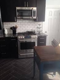 black kitchen cabinets with white subway tile backsplash black cabinets marinace black granite white subway tile