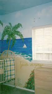lynda bergman decorative artisan painting a beach scene mural for she asked me paint the ocean on three walls