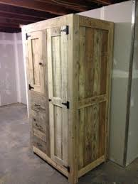 Wooden Storage Closet With Doors Dvd Storage Cabinets Wood Foter