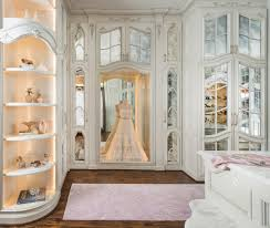 walk in closet with wedding dress display case transitional
