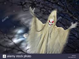 ghost ghoul demon haunting the night of halloween with the full