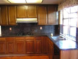 painting stained kitchen cabinets painting stained kitchen cabinets without sanding stain darker