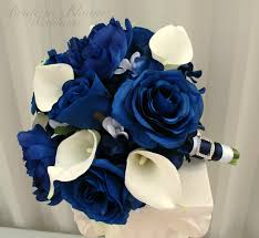 white blue roses blue calla wedding bouquet in bloom