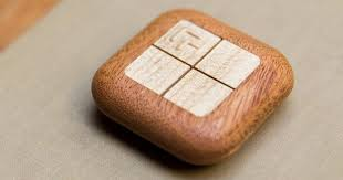 turn touch smart home controller is carved out of wood slashgear