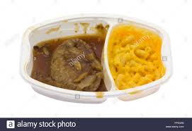 cuisine tv plus a microwaved salisbury steak plus macaroni and cheese tv dinner in a