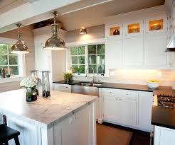 dual apron sink and gold gooseneck faucet cottage kitchen