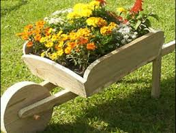 free plans to make this wooden garden wheelbarrow would be fun to
