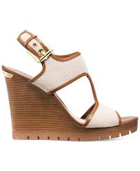 lyst michael kors michael gillian mid wedge sandals in natural